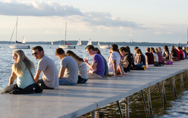 UW students relaxing on Memorial Union pier